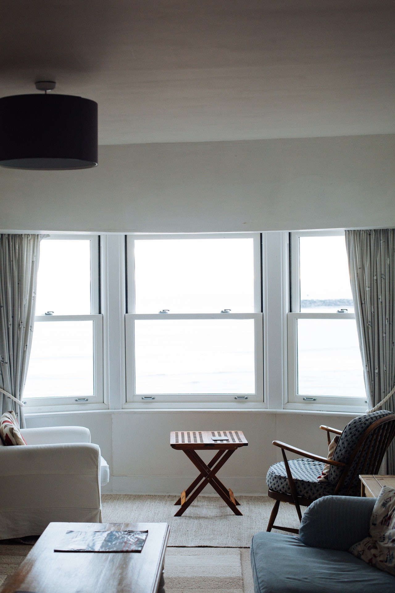 two-chairs-facing-towards-white-casement-window-776940